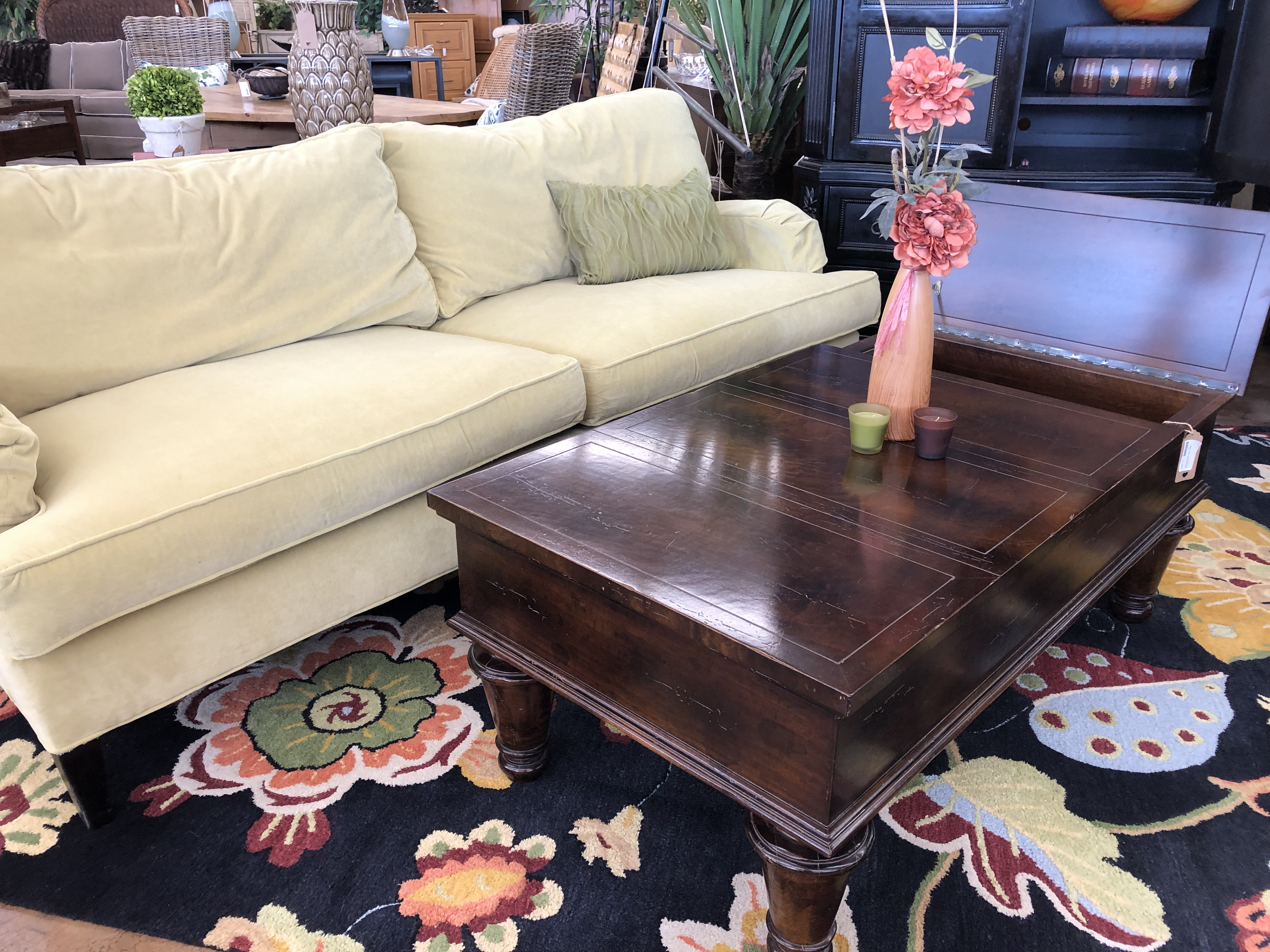 used dark wooden coffee table and light beige couch